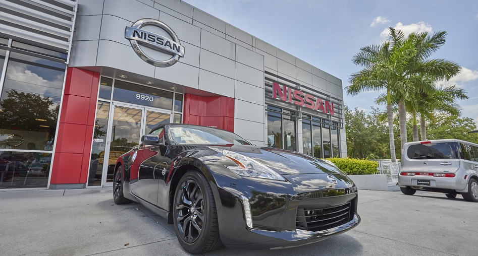 Exterior entrance to AutoNation Nissan Brandon dealer during the day