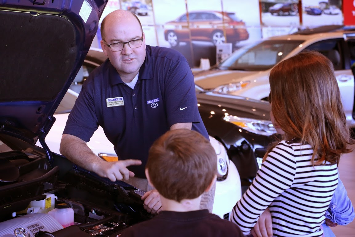 service tech at Balise Toyota Scion of Warwick explaining oil changes