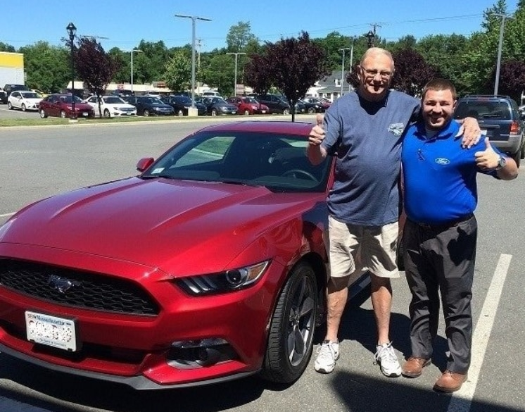happy new Ford Mustang owner at Balise Ford