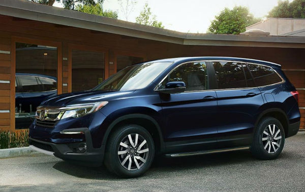 Baron Honda 2019 Honda Pilot East Patchoge,NY in front of house