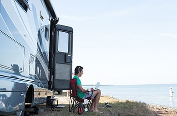 RV and person on computer