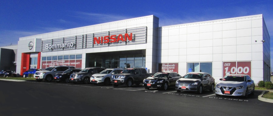 New Nissan cars in front of the Bommarito Nissan of Ballwin dealership.