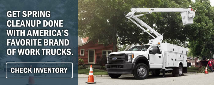 Photo of a New Ford F-450 Chassis Cab Truck upfitted with utility boxes and a bucket hoist, making tree cleanup in spring a snap.