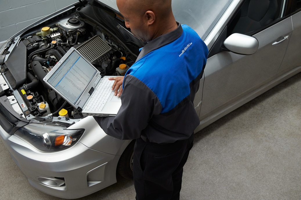 Subaru  Service Tech doing Diagnostic Work