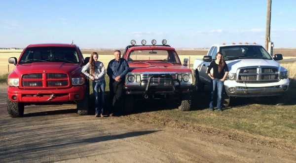 photo of the Bak family with their Ram truck collection