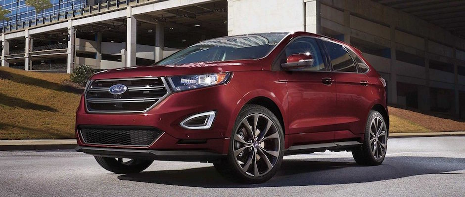 A Burgundy  Ford Edge Driving Out Of Parking Garage