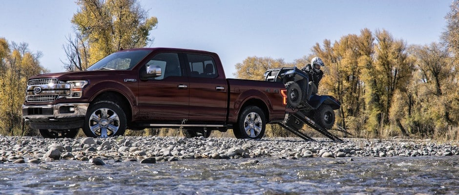A Person Taking Their Atv Off Of A Ford F  Lariat