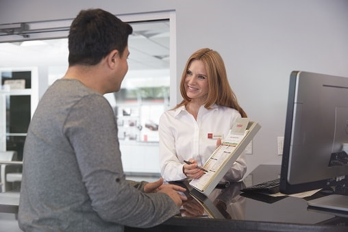 Nissan service & parts advisor working with customer