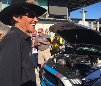 Richard Petty looks at the engine of the Ford Mustang GT King Premier Edition