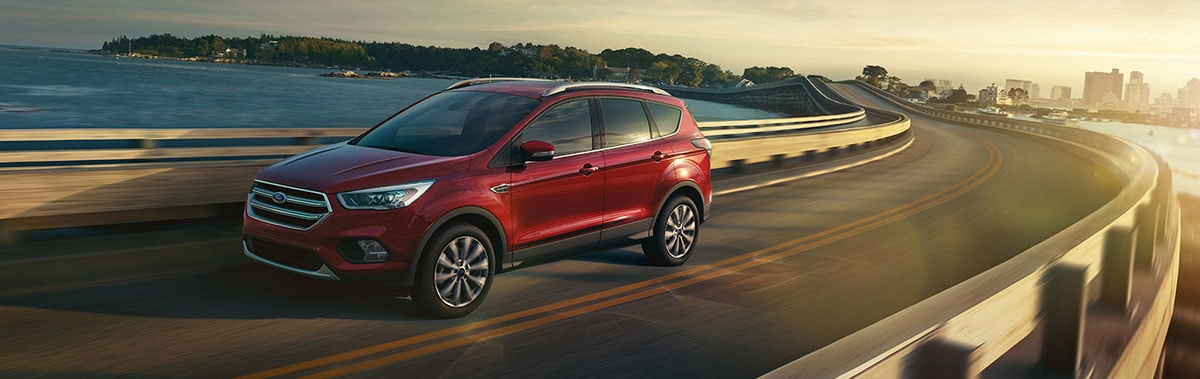2017 Ford Escape Titanmium driving on a bridge