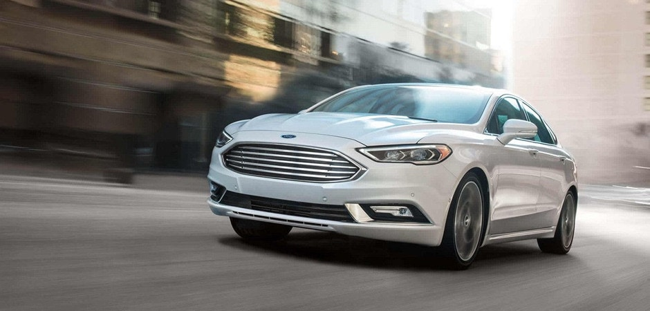 A 2018 Ford Fusion driving in the city
