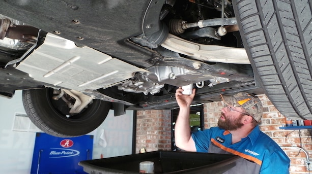 Picture Of A Mechanic Giving A Car An Oil Change - Ernest McCarty Ford