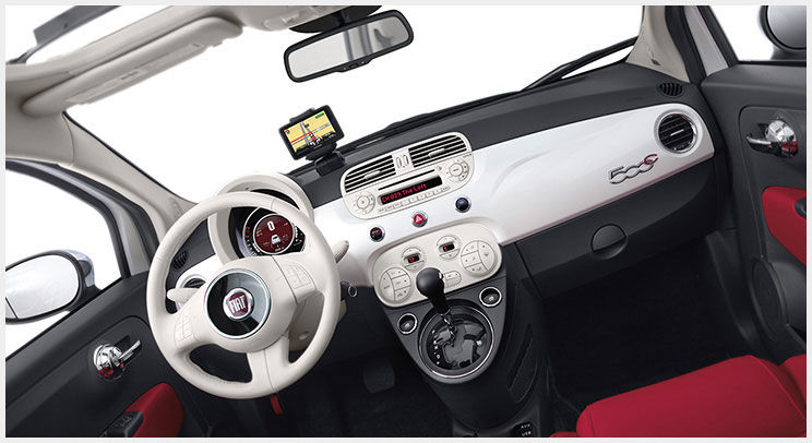 White and red interior of a 2015 FIAT 500c with the top retracted
