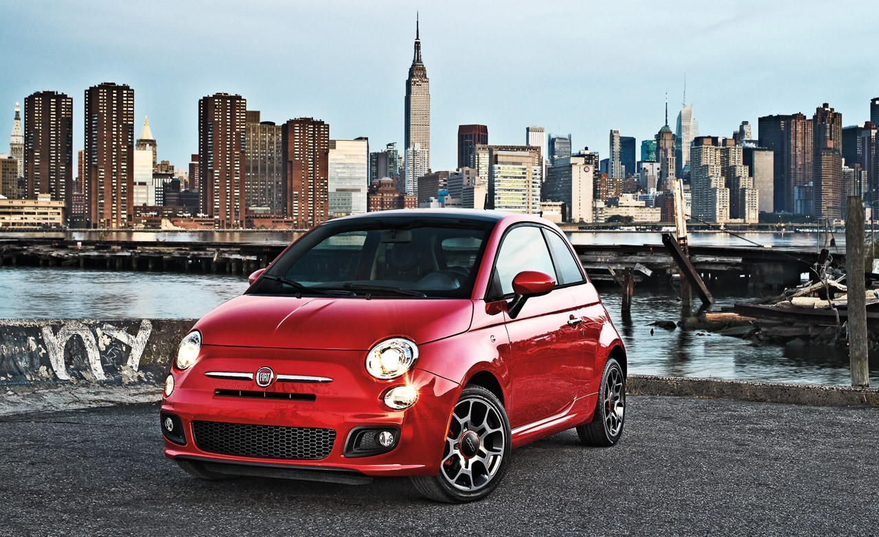 Red FIAT 500 in front on Manhattan