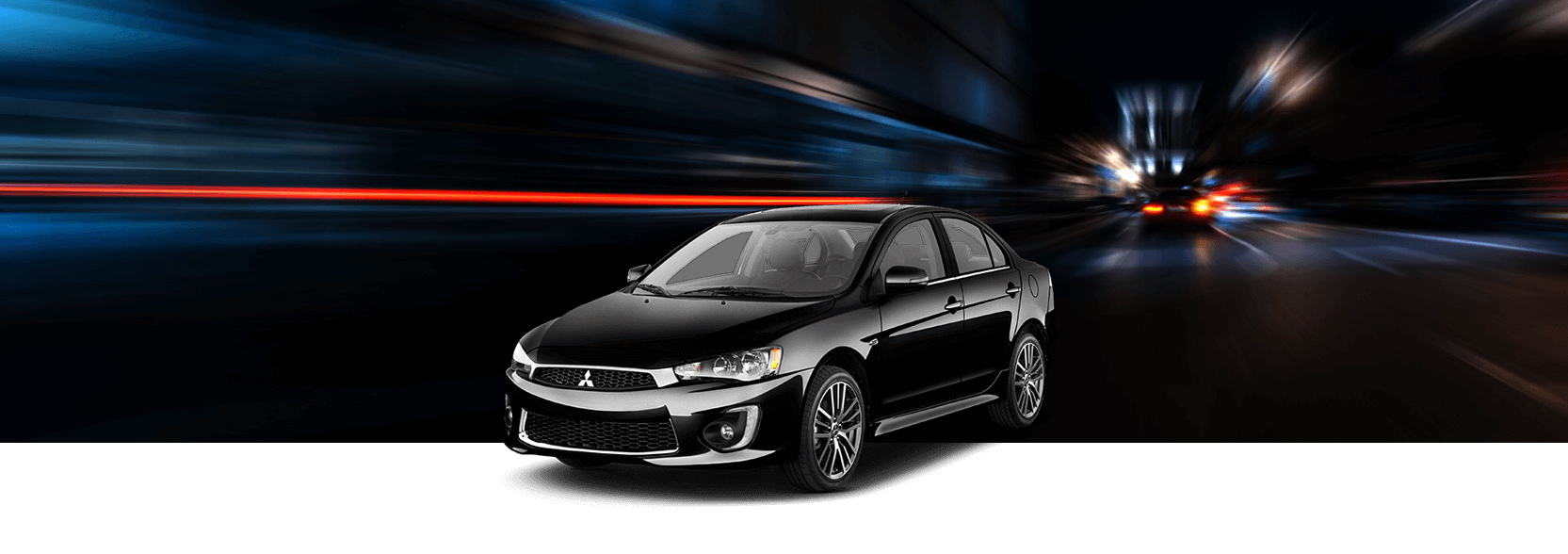 2017 Mitsubishi Lancer with blurred city banner