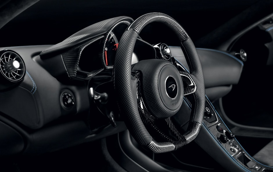 Carbon Fibre Steering Wheel with Extended Carbon Fibre Gear Shift Paddles. Available in Dimpled Leather (shown above) and Alcantara