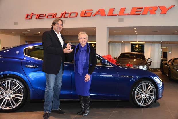 Harry Gray of Maserati Auto Gallery and Women's Guild member, Anna Sanders Eigler