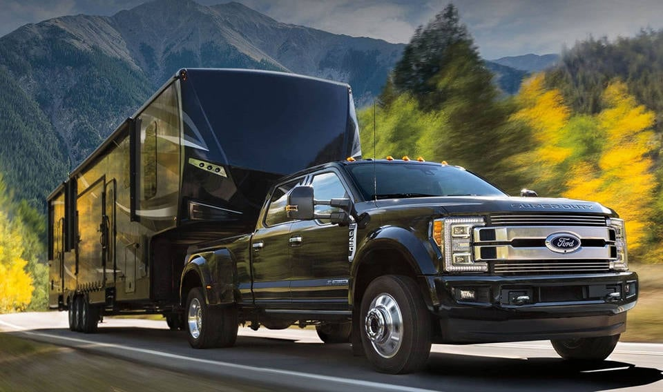 A 2018 Ford F-250 towing a horse trailer