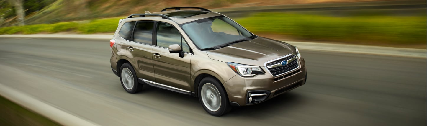 Subaru Forester Driving On A Roadway