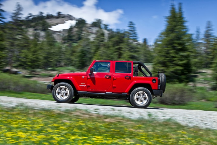 Jeep Wrangler Unlimited driving up mountain road