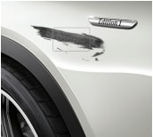 This is an example of a large fender scratch which qualifies as excessive wear and use on a Mercedes-Benz lease vehicle.