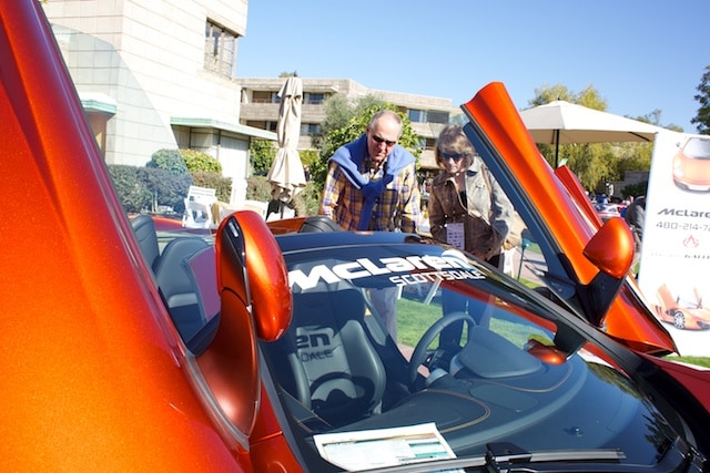 Potential clients inspect the new McLaren 12C