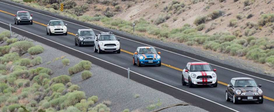Exterior view of CPO MINI vehicles cruising down the highway