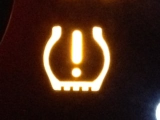 What looks like hazardous material symbol is actually a tire pressure warning.