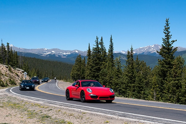 An all new Porsche 911 Carrera climbs Squaw Pass Road during the second annual Prestige Imports Mountain Tour
