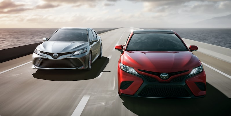 Two 2018 Toyota Camrys on the road picture