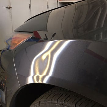 Dent on front wheel arch before repair at Reliable Collision Center in Springfield Missiouri
