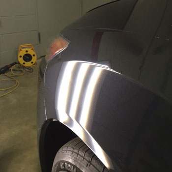 Dent on front wheel arch after repair at Reliable Collision Center in Springfield Missiouri
