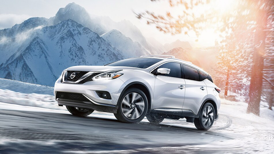 2015 Nissan Murano in White Driving in Snow
