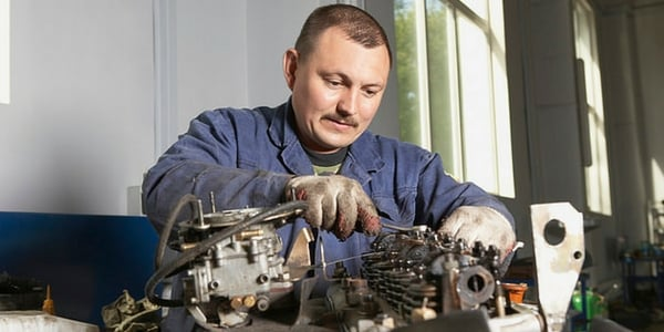 man fixing engine - vehicle Service frequently asked questions faq.jpg