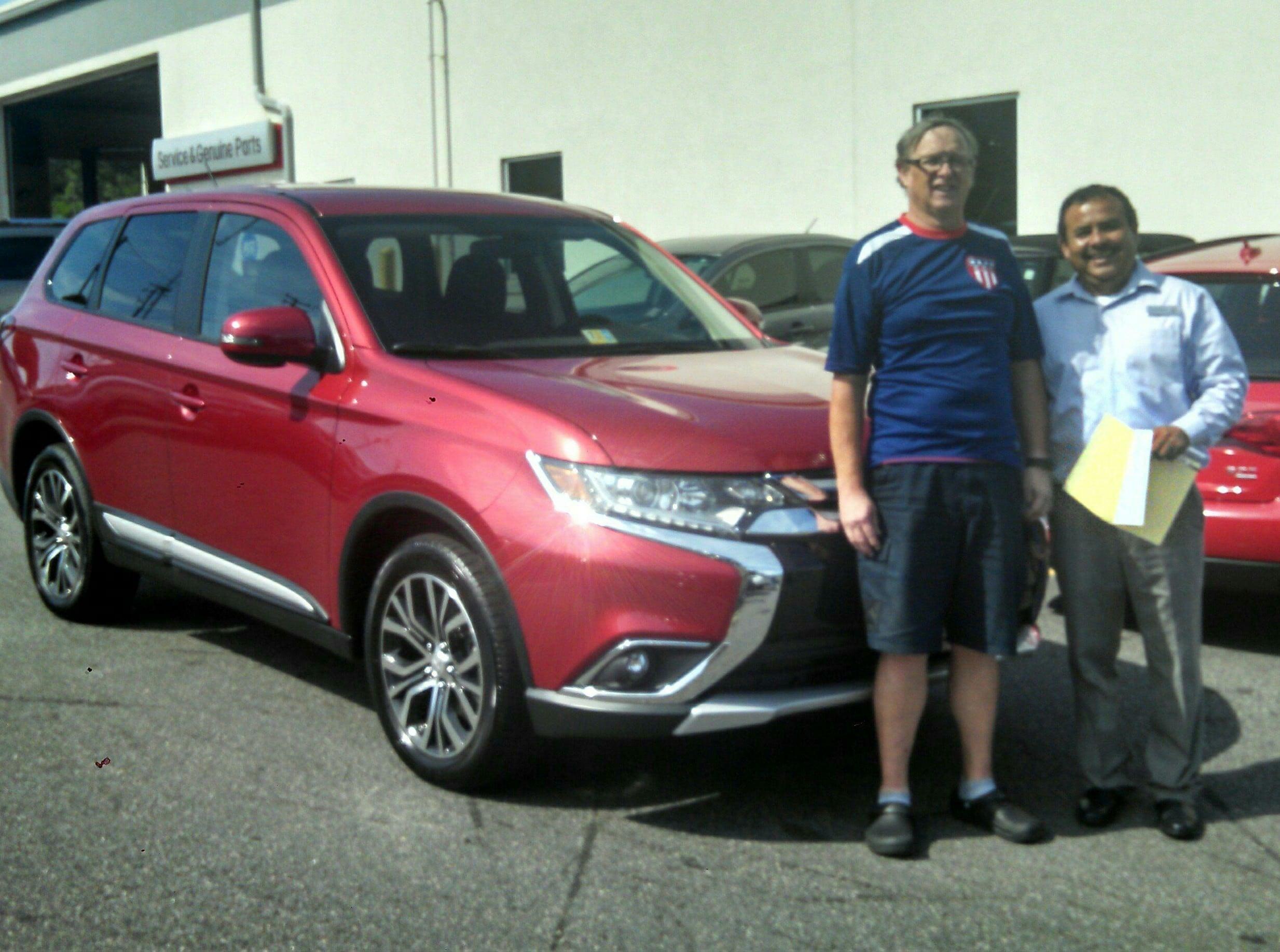 Happy Customer Robert Ainsworth with salesman Sal Sauceda.