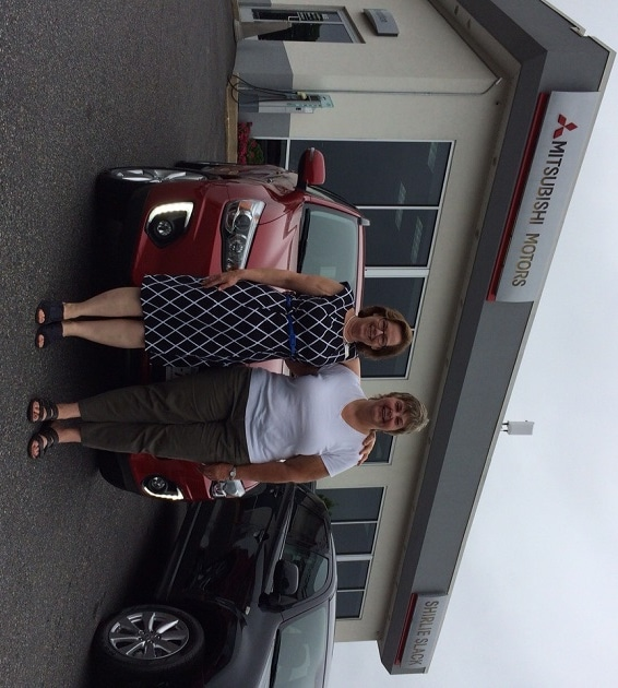 Patty Slack and Donna Windsor with Donna's new 2015 Outlander Sport.