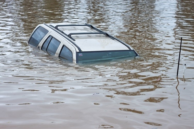 car sinking in water