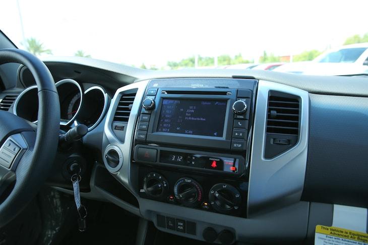 2011 honda ridgeline versus toyota tacoma for Honda dealership tacoma