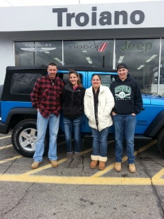 Family Photo After Purchasing New Jeep Vehicle - Troiano Chrysler Jeep Dodge