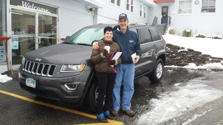 Photo Of Customer And Salesman With New Jeep Cherokee - Troiano Chrysler Jeep Dodge