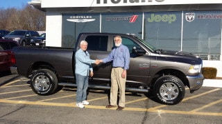 Photo Of Customer And Salesman With Ram Truck - Troiano Chrysler Jeep Dodge