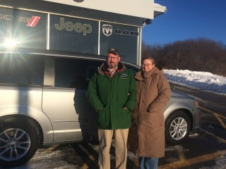 Photo Of Husband And Wife With New Dodge Van - Troiano Chrysler Jeep Dodge