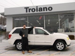 Photo Of Satisfied Customer Buying New Jeep Vehicle - Troiano Chrysler Jeep Dodge