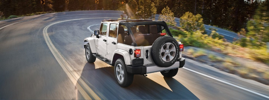 2018 Jeep Wrangler JK driving down a curved road