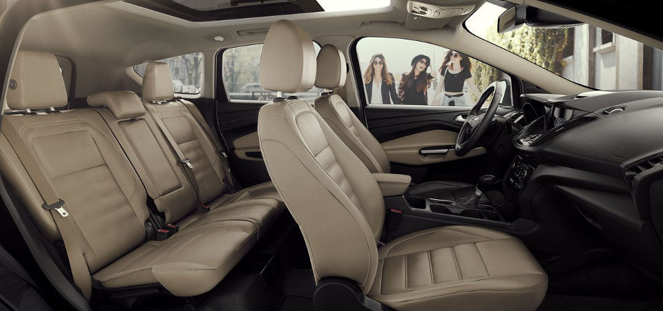 2017 Ford Escape interior image with three women approaching the vehicle