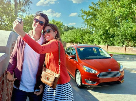 People taking a picture with their Ford Focus