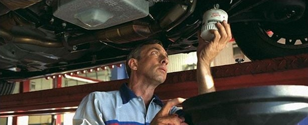A Ford Technician performing an oil change