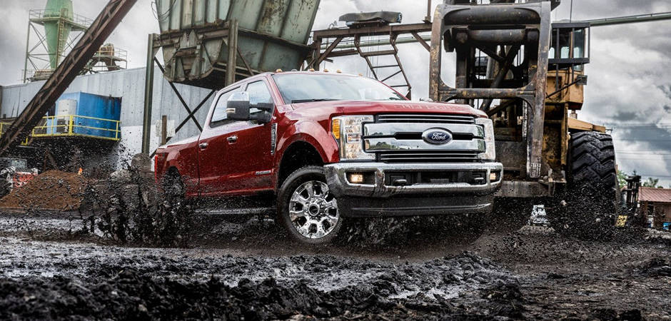 An F-250 driving through thick mud