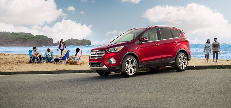 Ruby red 2017 Ford Escape at the beach
