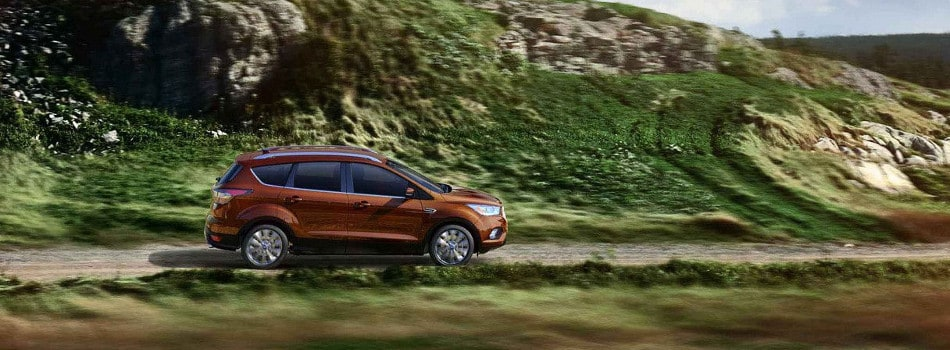 A 2018 Ford Escape driving through the mountains